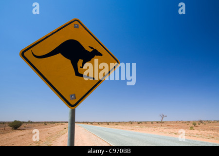 Kangaroo hazard sign on the highway, near Alice Springs, Northern Territory, Australia - Stock Photo