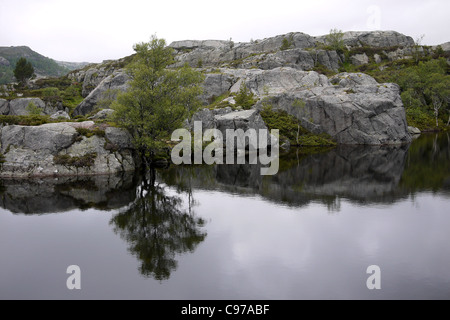 Preikestolen, or Pulpit Rock, above Lysefjorden, Forsand, Rogaland, Norway. - Stock Photo