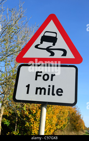Warning Road Sign 'Slippery Surface'.UK . - Stock Photo