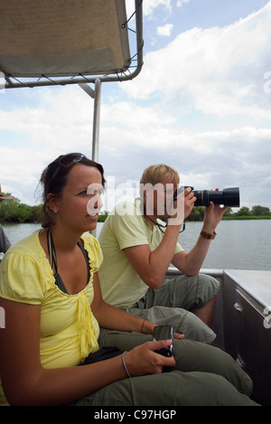 Tourists on a wildlife cruise in the Mary River Wetlands.  Mary River National Park, Northern Territory, Australia - Stock Photo