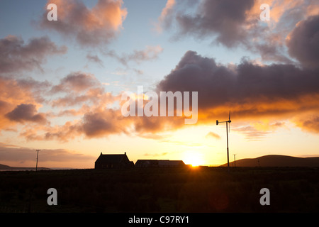 A small scale wind turbine powering a house on Hoy in Orkney, Scotland, UK. - Stock Photo