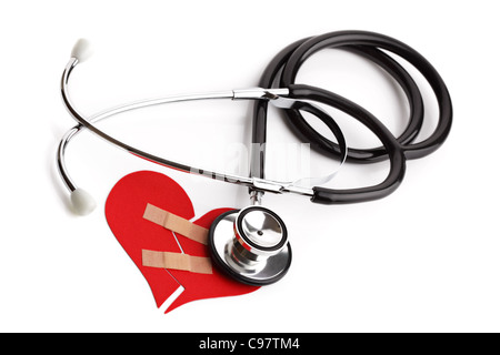 Stethoscope and broken heart concept for heart disease or illness - Stock Photo