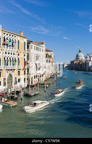 Water taxis on the Grand Canal from Ponte dell' Accademia bridge with Chiesa di Santa Maria della Salute in the - Stock Photo
