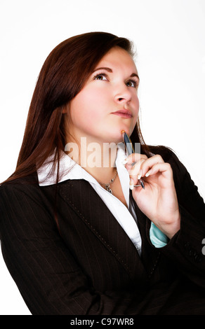 young woman thinking something to herself - Stock Photo