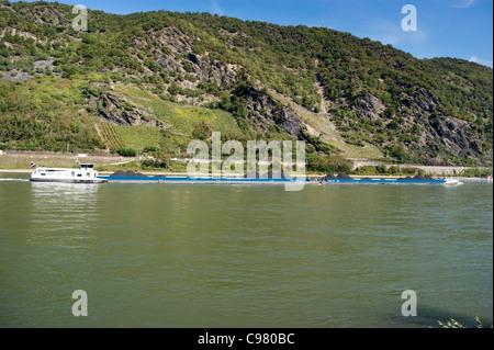 Coal freighter on the River Rhine, Bacharach, Rheinland-Pfalz, Germany - Stock Photo