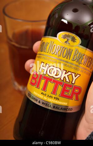 Hooky Bitter beer bottle label brewed by Hook Norton Brewery - Stock Photo
