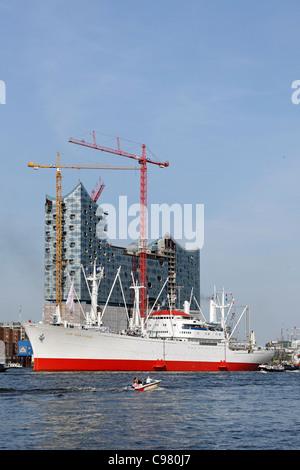 Philharmonic hall under construction and Cap San Diego museum ship, Elbe river, Hamburg, Germany, Europe - Stock Photo