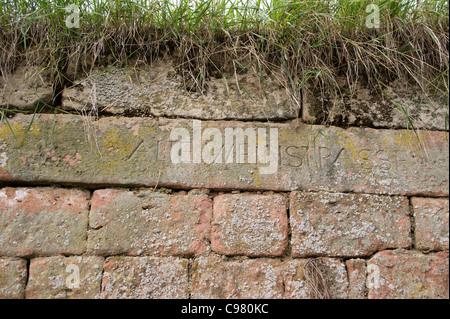 Ancient inscription on a vineyard wall in the wine village of Ungstein near Bad Duerkheim  Rheinland-Pfalz, Germany - Stock Photo
