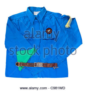 Vintage 1970's Girl Guides Association blue uniform shirt, leather belt, buckle and green necker (Swindon, England) - Stock Photo