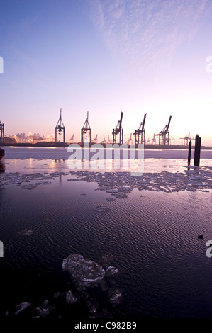 Floating ice floes in Hamburg Harbour, harbour cranes, in the evening, Hamburg, Germany, Europe - Stock Photo