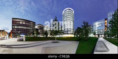 Panoramic view of International Coffee Plaza Tower at night, Sandtorpark, Hafencity harbor city, Hamburg - Stock Photo