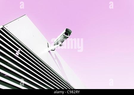 Surveillance camera on a building, cctv, vanilla sky - Stock Photo