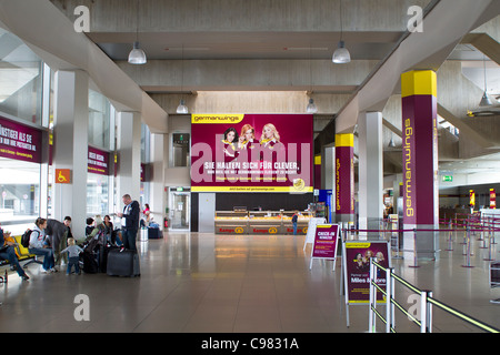 Waiting area in Bonn-Cologne airport with Germanwings billboard. - Stock Photo