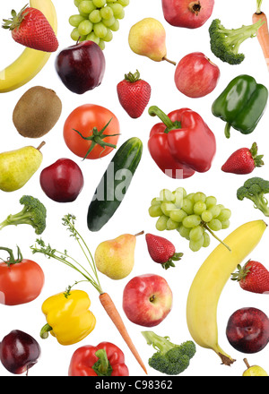 Colorful pattern of fruits and vegetables falling over white background - Stock Photo