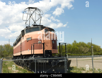 front view of an ntique orange and black locomotive in Milwaukee , USA - Stock Photo