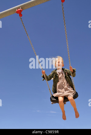 Small 6-year-old blonde girl on a playground, Germany, Europe - Stock Photo