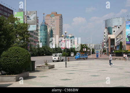 Modern tree lined street in Fengdu, China - Stock Photo