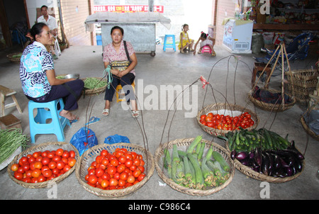 Vegetables in carry baskets at a market in Fengdu, China - Stock Photo