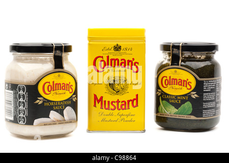 Three Colmans products mustard powder tin mint sauce and horseradish sauce - Stock Photo