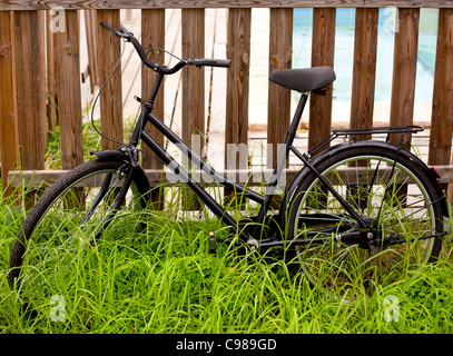 vintage bicycle in fence - Stock Photo