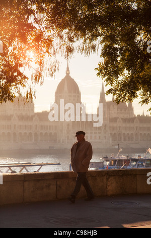 Budapest, Riverbank and Hungarian Parliament Building at Sunrise - Stock Photo