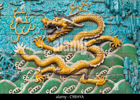 Detail of the Nine Dragons Screen, Palace of Tranquility and Longevity, Forbidden City, Beijing, Peoples Republic - Stock Photo