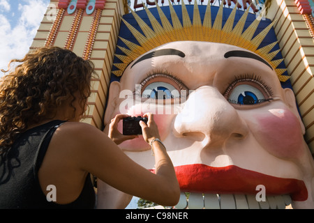 A woman photographs the smiling face of Luna Park - Sydney's historic amusement park.  Sydney, New South Wales, - Stock Photo