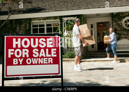 Mature couple moving into newly bought property - Stock Photo