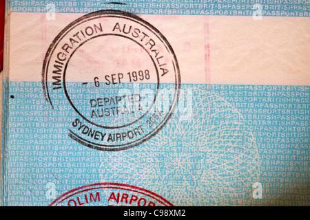 Immigration Australia stamp in British passport - Stock Photo