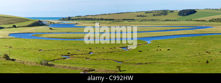 Panoramic photo of the River Cuckmere meeting the English Channel at  Cuckmere Haven, south coast, East Sussex, - Stock Photo