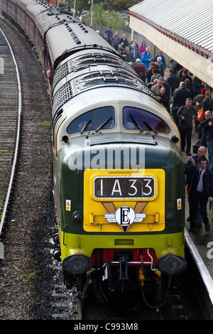 1A33 Deltic diesel Train and carriages, crowded train platform with passengers at Ramsbottom Station, East Lancashire - Stock Photo
