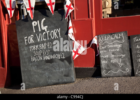 'Pig for Victory' Menu Board outside Cafe selling pig and meat products, Pickering, England, UK - Stock Photo