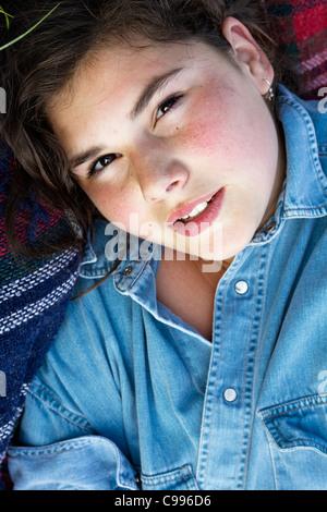Naughty girl with denim shirt, summer close-up - Stock Photo