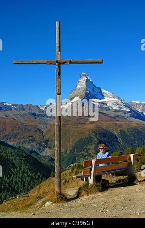 Resting place with a wooden cross at Sunnegga on the Gornegrat mountain railway. at Zermatt, Valais, Switzerland - Stock Photo