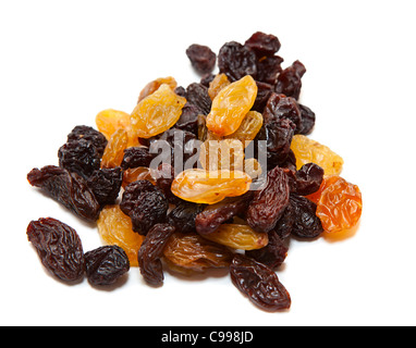 Pile of dark and light raisins isolated on a white background. - Stock Photo