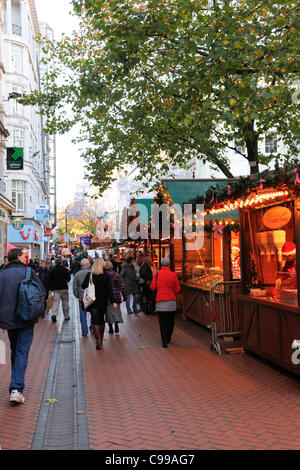 Shoppers and stalls in Birmingham German Market..Taken on the opening day 17th November 2011. - Stock Photo