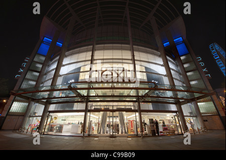 A night time shot of the entrance / storefront to the Next flagship store in Manchester with no people (Editorial - Stock Photo