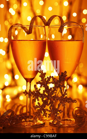 Romantic holiday dinner, celebration of Christmas or new year eve, party with Champagne and festive gold ornament - Stock Photo