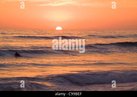California surfers at sunset - Stock Photo