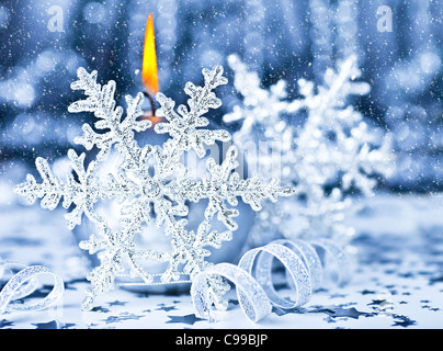 Beautiful Christmas decoration, blue holiday background with candle light & snowflake, winter holidays celebration, - Stock Photo