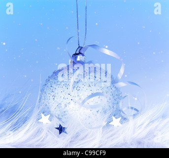 Beautiful Christmas tree decoration,blue ball over cold snow background, traditional Christian winter holiday, ornamental - Stock Photo