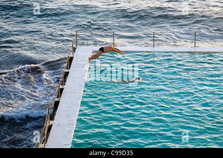 Early morning swimmers at the Bondi Icebergs pool also known as the Bondi Baths. Bondi Beach, Sydney, New South - Stock Photo
