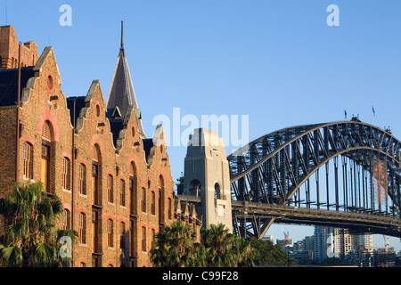 The architecture of the Australasian Steam Navigation Co. building and Harbour Bridge.  Sydney, New South Wales, - Stock Photo