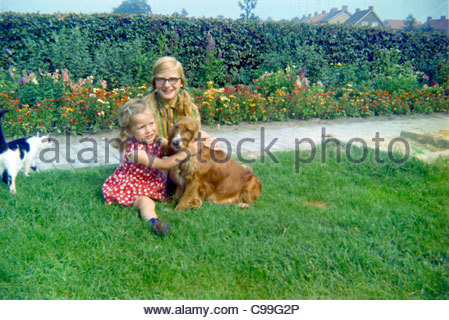 sisters posing with dog rural Holland 1960s - Stock Photo