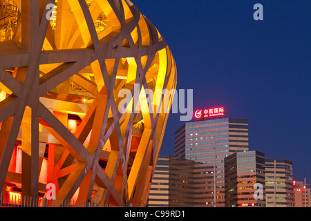 National Olympic Stadium and skyscrapers, Beijing, PRC, People's Republic of China, Asia - Stock Photo