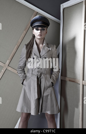 Young woman police officer in coat, portrait - Stock Photo