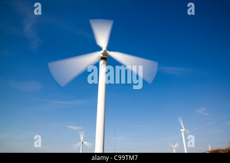 Wind Farm, Wind Turbine against blue sky - Stock Photo