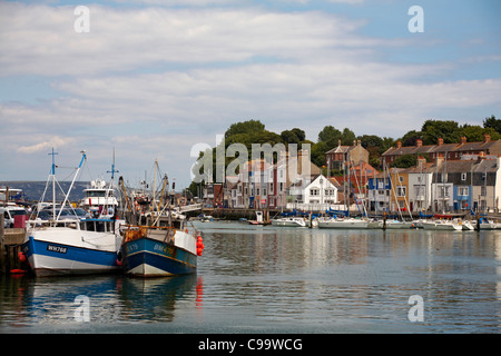 Boats moored along the quay at Weymouth in July - Stock Photo
