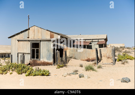 Abandoned factory in Kolmanskop the former mining town in Namibia - Stock Photo