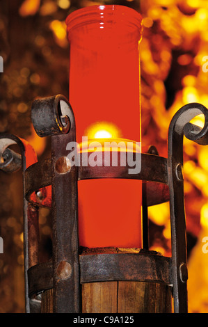 Spain, St. James Way: Candle light in the Colegiata of Roncesvalles - Stock Photo